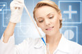 Lab worker holding up test tube picture of beautiful Royalty Free Stock Image