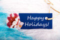 Label with happy holidays and beach and holiday background Royalty Free Stock Photos