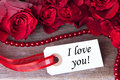 Label with i love you the word and roses as background Stock Photography