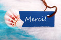 Label with merci nautical background the french word which means thanks Royalty Free Stock Photography