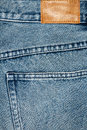 Label sewed on a blue jeans blank leather Stock Photography