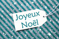 Label On Turquoise Paper, Snowflakes, Joyeux Noel Means Merry Christmas Royalty Free Stock Photo
