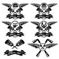 labels with pistons and skulls with wings Royalty Free Stock Photo