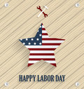 Labor day poster with striped star, wrench and hammer. Wooden background Royalty Free Stock Photo