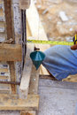 Labor man using a plumb bob for check Royalty Free Stock Photo