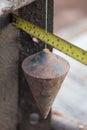 Labor man using a plumb bob for check pillar Royalty Free Stock Photo