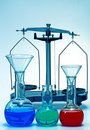 Laboratory balance and glassware Stock Photography