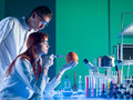 Laboratory experiment on a grapefruit two scientists conducting an in Stock Image