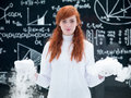 Laboratory experimental studies general view of a pretty girl student in a chemistry lab conducting a magical gas experiment with Royalty Free Stock Image