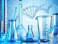 Laboratory glassware on color background Royalty Free Stock Photo