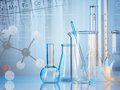 Laboratory glassware on color background Royalty Free Stock Photos