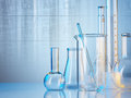 Laboratory glassware on color background Stock Photo