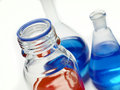 Laboratory glassware filled with colorful liquids Stock Images