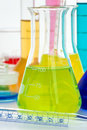 Laboratory glassware with various colored liquids Royalty Free Stock Photo