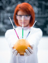 Laboratory grapefruit experiment macro of a handheld injected by a woman in a chemistry lab Royalty Free Stock Images