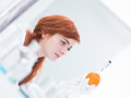 Laboratory injected orange close up of woman in a analyzing an Royalty Free Stock Image