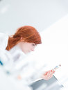 Laboratory pills analysis blurred lab side view of a woman analysing in a tube Royalty Free Stock Photos