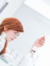 Laboratory pills examination close up of woman in a studying some holded in a tea bag Royalty Free Stock Photos