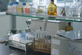 Laboratory test bottles placed neatly shelf Stock Images