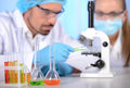 Laboratory two scientists conducting research in a lab environment Stock Images