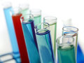 Laboratory vials filled with colorful liquids shot on white background Stock Photo