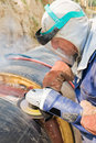 Laborer and grinder machine Stock Image