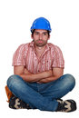 Laborer sitting with arms crossed Stock Images