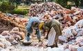 Laborers loading chunks of rock salt Royalty Free Stock Photo