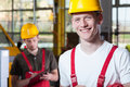 Laborers in overalls and hardhat Royalty Free Stock Photo