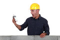 Labourer alarmed by the time Royalty Free Stock Photo