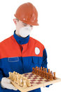 Labourer with chess Royalty Free Stock Photo