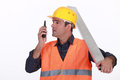Labourer speaking into walkie talkie a Royalty Free Stock Image