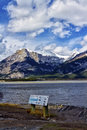 Lac des arcs alberta with part of the canadian rocky mountains in the background thru a fisheye lens Stock Photos