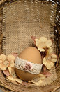 Lace decorated easter egg with and artificial flowers in a basket Royalty Free Stock Images