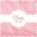 Lace doily border on a pink textured shabby polka dot background Royalty Free Stock Photo