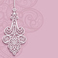 Lace pendant on ornamental pink background