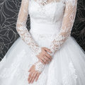 Lace white wedding dress with long sleeves women s hands Royalty Free Stock Photo
