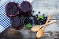 вlack currant jam on the old table Stock Photos