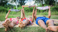 Lack of education poverty countryside boys laying on ground together reading books and enjoy concept Stock Photography