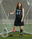 Lacrosse girl goalie march ogla oregon girls hillsboro oregon century high school jaguar senior amber wise sporting her leg and Royalty Free Stock Photography