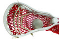 Lacrosse Head with a Grey Ball Royalty Free Stock Image