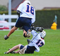 Lacrosse leaping Royalty Free Stock Photography