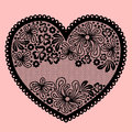 Lacy heart on pink background Stock Photos
