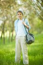 Lad in casual portrait of cute clothes looking at camera outside Royalty Free Stock Photography