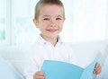 Lad with copybook boy spending leisure at home Stock Photos
