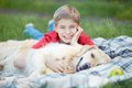 Lad and his pet portrait of cute fluffy lying on plaid Royalty Free Stock Photo