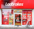 Ladbrokes gambling betting company uk based gaming can be found on most high streets offices today are growing in strength with Royalty Free Stock Image