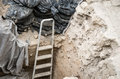 Ladder at archaeological dig a pit a in lisbon portugal Royalty Free Stock Photo