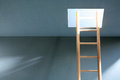 Ladder in hatch escape concept wooden empty room with illuminated ceiling Stock Photo