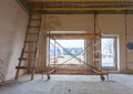 Ladder in the mirror and parts of scaffolding during on the remodeling, renovation and construction of apartment Royalty Free Stock Photo